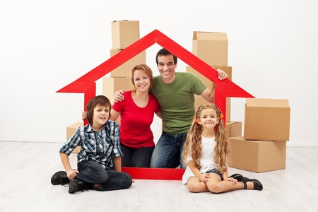 home insurance: Happy family with kids moving into a new home - sitting with cardboard boxes