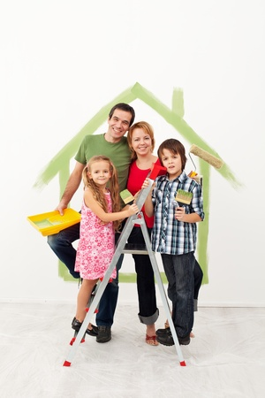 Happy family with kids redecorating their home together