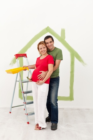 Happy couple expecting a baby redecorate their new bigger home photo