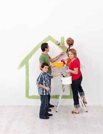 Happy family with two kids redecorating their new home together photo