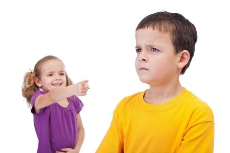 spurn: School bullying concept with girl mocking a sad boy