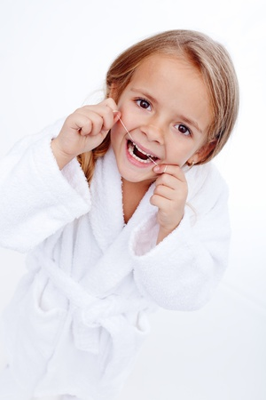 Little girl flossing - oral hygiene education in childhood photo