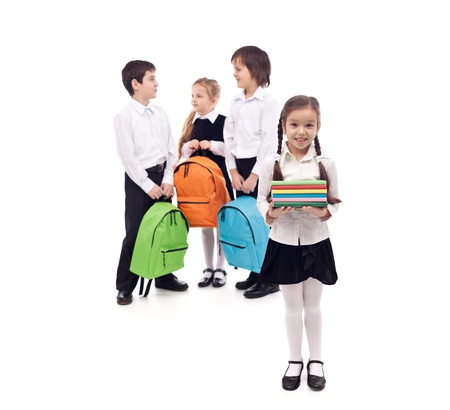 returning: Kids returning to school with books and backpacks - isolated