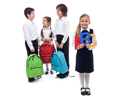 Back to school concept with a group of kids talking - isolated Stock Photo