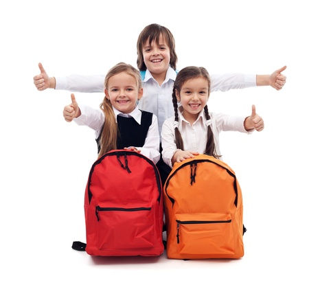 giving back: Back to school concept with happy kids giving thumbs up sign - isolated