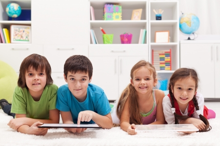Happy kids using tablet computers