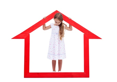 home protection: Little girl in the safety of her home concept - isolated Stock Photo