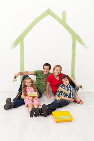 Happy family with kids redecorating their home together concept photo