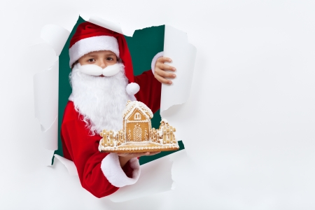 busy beard: Santa giving you a surprise present - a gingerbread cookie house