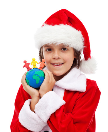 Merry christmas for all the world concept - child holding clay figure earth and people photo