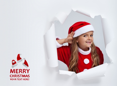 Santa hears your christmas wishes - little girl eavesdropping on your dreams, with copy space photo