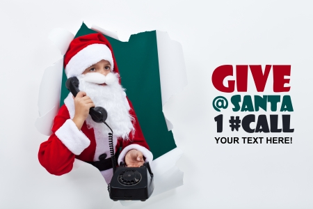 busy beard: Santa on the phone announcing the start of the holiday season - copy space