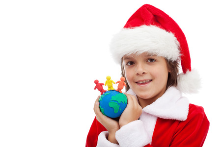 Christmas together concept - boy holding globe with different clay people, isolated photo