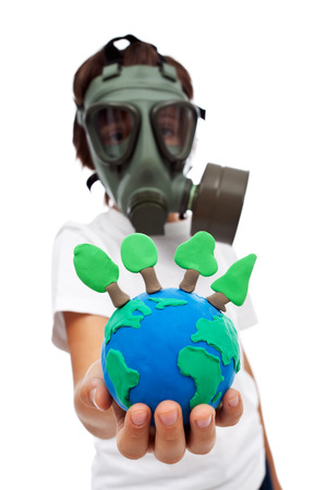 kids wear: Preserving our forests - ecology concept with child wearing gas mask holding earth globe, isolated