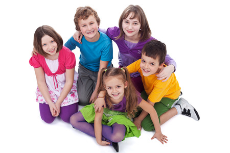 Group of kids sitting on the floor holding to each other - isolated photo