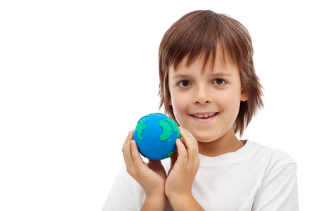 Happy kid holding earth globe made of clay - ecology concept, isolated photo