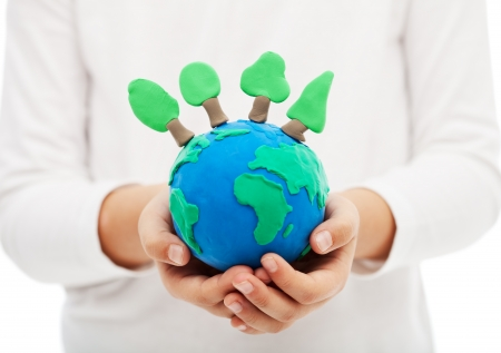 hands holding earth: Protecting the forests and ecology concept - child hand holding earth globe with trees