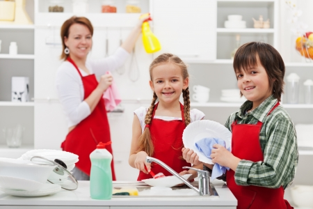 house chores: Family cleaning the kitchen and washing dishes