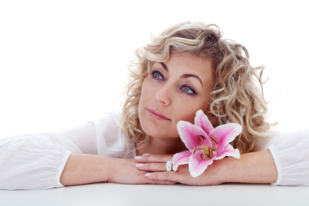 Blonde woman portrait with pink lily flower - isolated photo