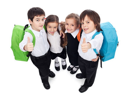 kid sitting: Group of kids holding and giving thumbs up sign - back to school concept, top view