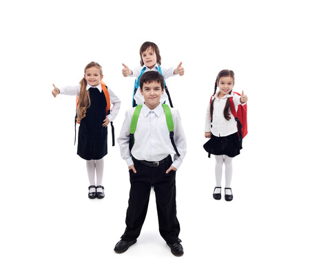 school children uniform: Back to school concept with happy and cool kids - isolated Stock Photo