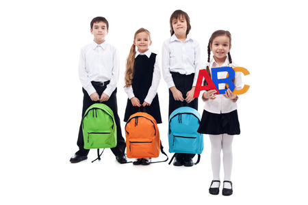 Back to school concept with kids holding colorful schoolbags - isolated photo