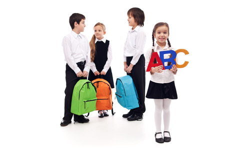 Group of school kids with colorful bags - isolated photo