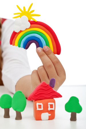clay craft: Child hand with modelling clay creations - closeup Stock Photo