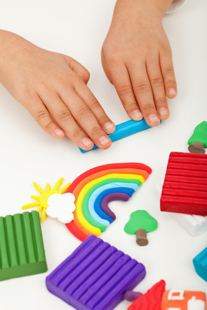 clay modeling: Child hands with modelling clay - closeup