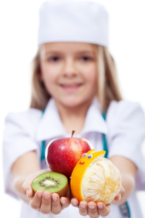 Happy fruits for a healthy life - little girl with fresh fruits