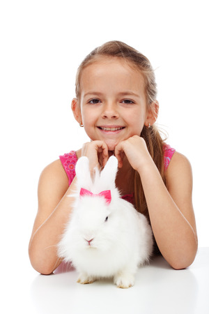 lionhead: Little girl with her adorable white rabbit - isolated