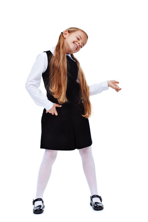 air guitar: Happy little girl in stylish outfit with air guitar - pointing with her hand and head, isolated Stock Photo