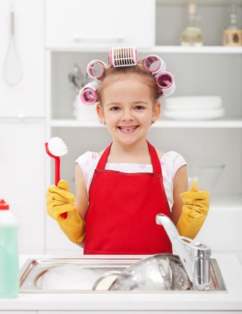 해피 하우스 키핑 요정 - 미소를 요리 세척 스톡 콘텐츠