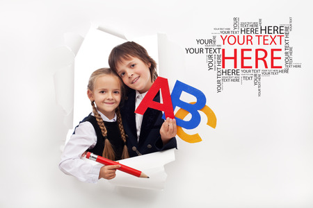 Back to school season opening - two happy kids with school items Stock Photo
