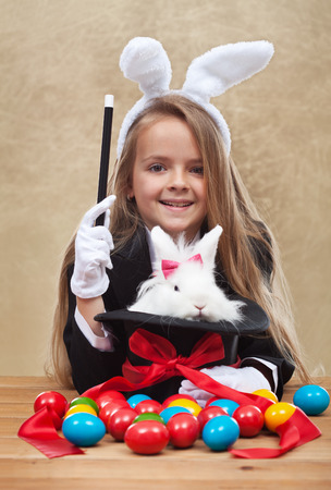 conjuring: Conjuring the easter rabbit - young magician perform a seasonal trick