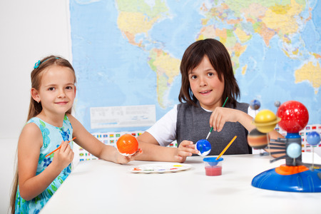 elementary: Kids in science and arts class -focus on girl face Stock Photo