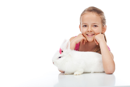 lionhead: Happy young girl and her grumpy white bunny - isolated Stock Photo