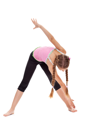 Young girl doing stretching and flexibility gymnastic exercise - isolated Zdjęcie Seryjne