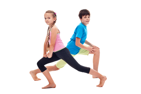 Healthy and happy kids doing leg strengthening and flexibility exercises - isolated