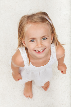 Happy little girl looking up with a large smile on her face - happiness concept Zdjęcie Seryjne