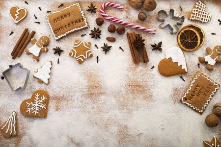 Holiday season sweets - gingerbread cookies with ingredients on the table - top view, copy space Foto de archivo