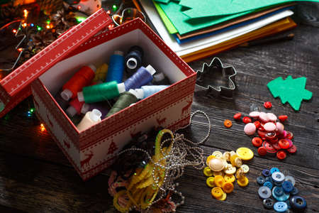 sewing box: colored thread in the new year or Christmas box! Stock Photo