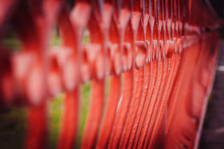 focus on the details of the bridge, red patterned railings , wedding Stock Photo