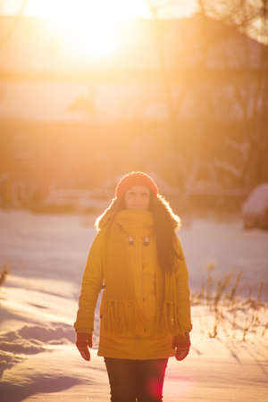 Portrait of romantic girl at sunset, sunrise, gold per hour on a frosty winter day,evening Stock Photo