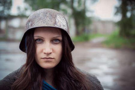 servicewoman: will rub girls in an old military helmet of times  World War II