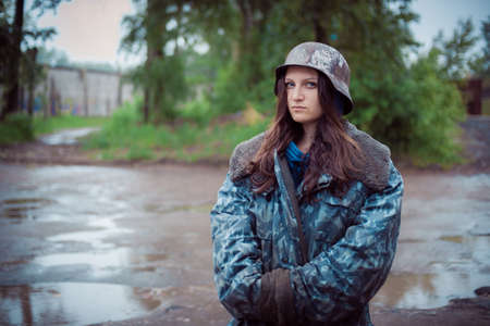 will rub girls in an old military helmet of times World War II