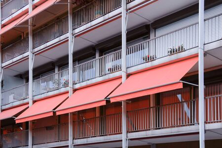 Beautiful balcony with coral awning in apartment house. Archivio Fotografico