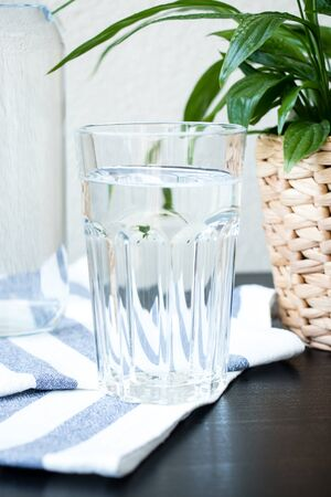 A glass of water with a blurred background. Top view. Fresh image.