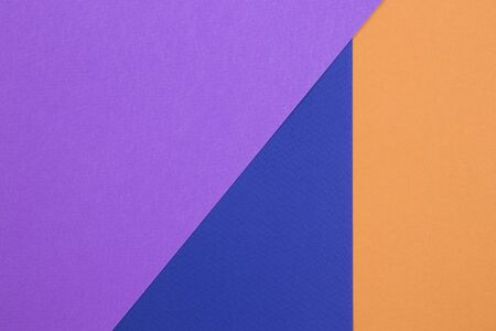 Background with violet, blue and orange colors. Flat lay for your design. Trendy colors.