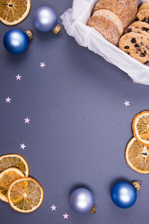 Cookies with christmas decor on a blue background. Christmas concept. Space for your text.